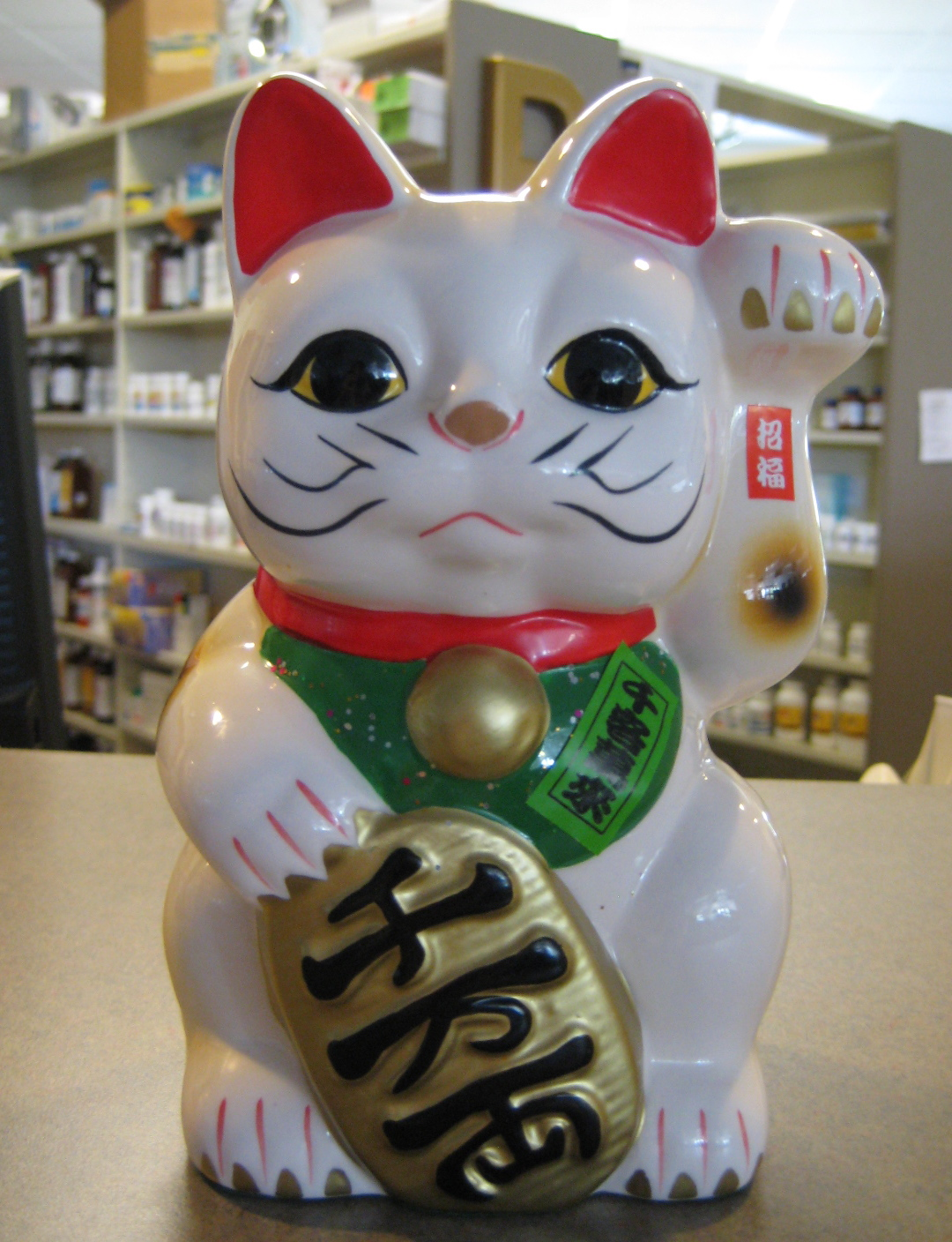 Things That Bring Good Luck the lucky cat brings good luck to the pharmacy.