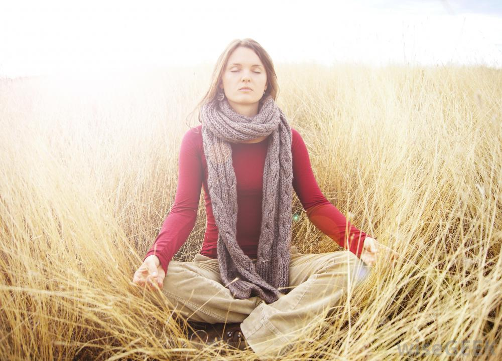 woman-sitting-in-field-with-aura